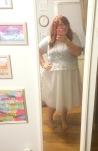 Party day outfit debuted the white tulle skirt, a cropped powder blue top, a flower headband, and gold glitter flats (not pictured).